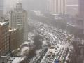 哈尔滨春分大雪纷飞 早高峰交通拥堵
