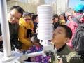 """今天(23日)是第五十九个世界气象日,主题是""""太阳、地球和天气""""。中国气象局举行系列科普活动,并免费向公众开放。图为图为活动现场。简菊芳 摄影"""