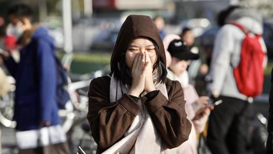 """寒风刺脸 北京街头寒冷下的""""微表情"""""""