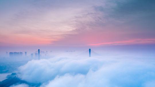 梦幻粉 航拍冬雾霞光中的荆州长江大桥