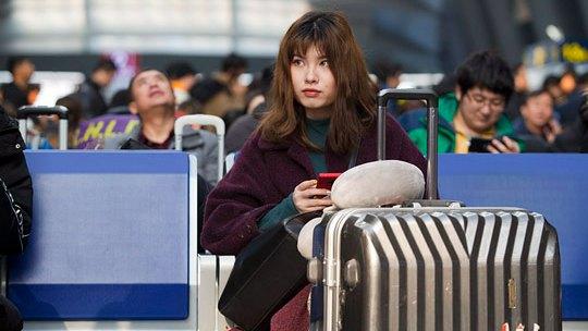 """镜头记录中国式回家路:""""关键词""""看春运"""