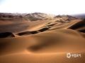 中国天气网讯 新疆鄯善县库木塔格沙漠被称为世界上离城市最近的沙漠,茫茫沙漠,只见沙黄天蓝,蔚为壮观。图为一座座沙山层层叠叠。(图/梁泽浩 文/苏庆红)